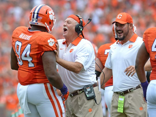 Clemson assistant coach Dan Brooks celebrates with defensive tackle Carlos Watkins (94) after Watkins returned an interception for a touchdown against Appalachian State on Sept. 12, 2015, at Clemson's Memorial Stadium.