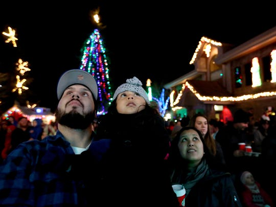 Arianna Gutierrez, 3, watches the lights turn on with
