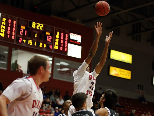 Mark Ogden recorded his sixth double-double of the year with game-highs of 26 points and 13 rebounds to lead Dixie State past Hawaii Pacific, 84-63, Saturday night in the Burns Arena.