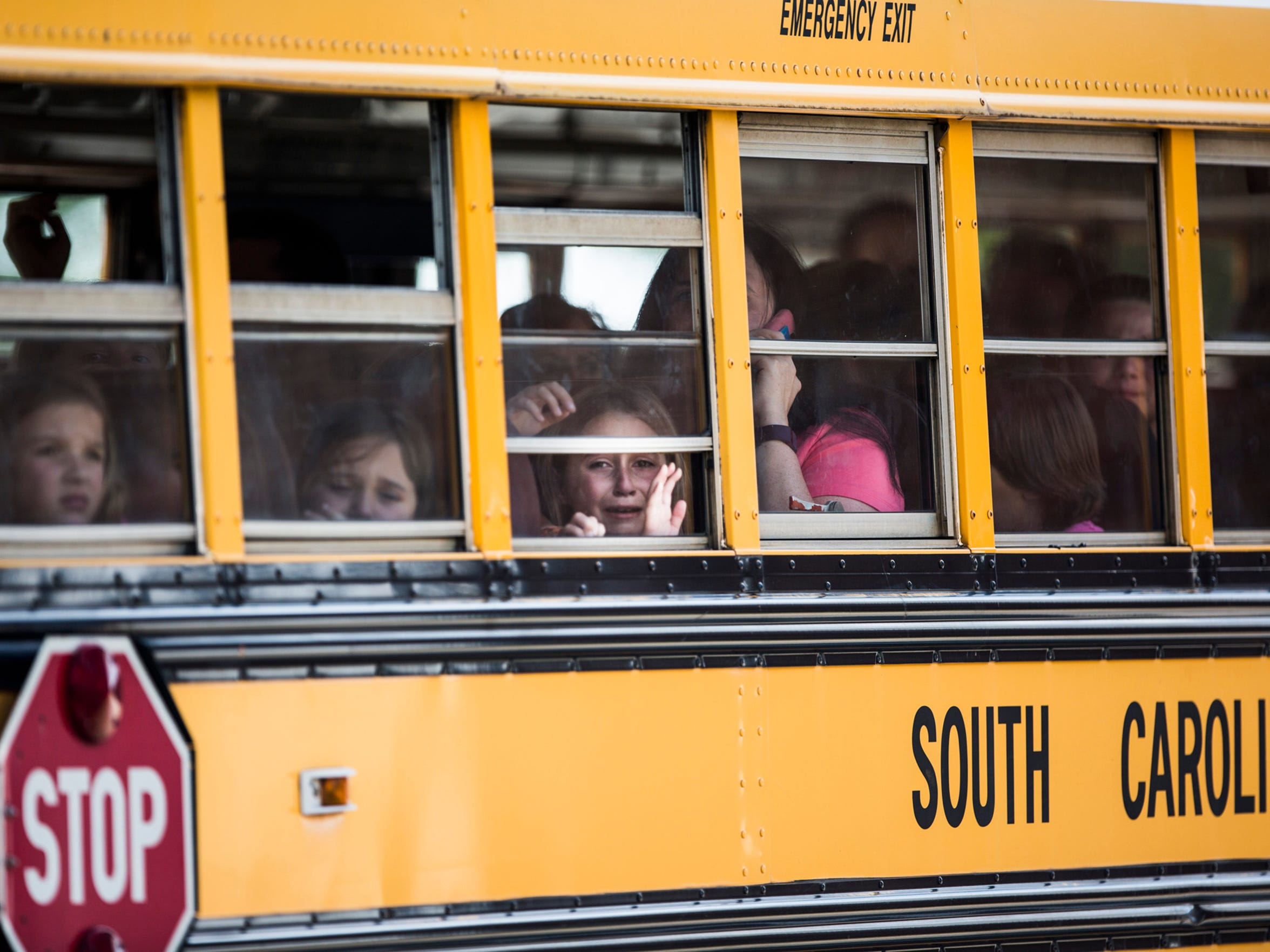 A Townville Elementary student weeps as she and her classmates are transported to Oakdale Baptist Church following a shooting at Townville Elementary that claimed one adult life and injured two children on Wednesday, September 28, 2016 in Townville.