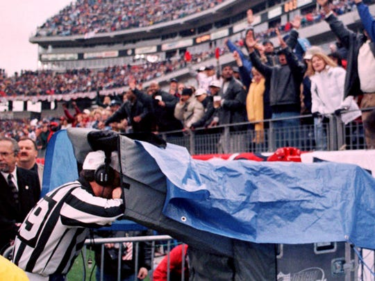Referee Phil Luckett checks the replay of the Titans kickoff return for a touchdown with seconds left against the Bills on Jan. 8, 2000. The play was reviewed to confirm the line judge ruling that is was a lateral and not an illegal forward pass.