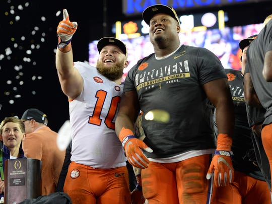 Clemson linebacker Ben Boulware (10) and defensive tackle Carlos Watkins (94) celebrate after the Tigers defeated Alabama, 35-31, in the national championship game at Raymond James Stadium in Tampa on Jan. 9.