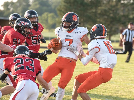 Galion's Tanner Crisman is spun around by the Bucyrus