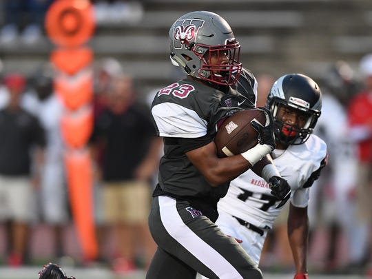 Westside's Paul Johnson (23) scores against Westwood on Friday, August 25, 2017.