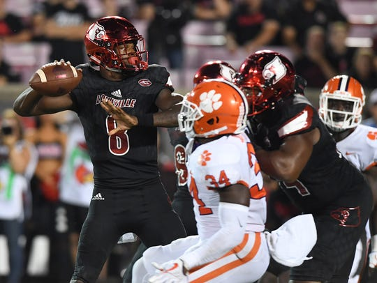 Louisville quarterback Lamar Jackson (8) passes against