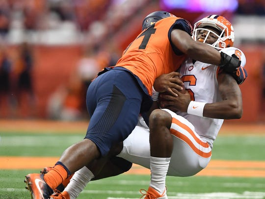 Syracuse defensive lineman Alton Robinson (94) sacks