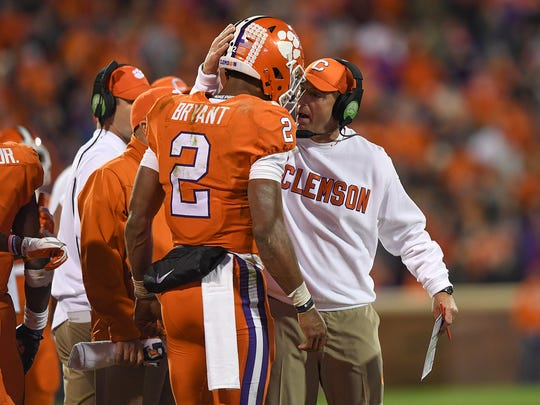 Clemson head coach Dabo Swinney congratulates quarterback Kelly Bryant (2) after the Tigers scored against Florida State during the 4th quarter on Saturday, November 11, 2017 at Clemson's Memorial Stadium.