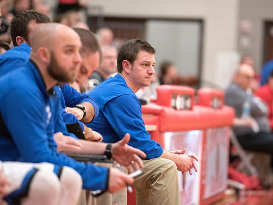 Chris Sheldon coaches his Western Reserve team in the