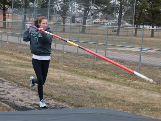 Lakeview senior Hannah Emery works on her pole vault