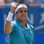 Luxembourg's Gilles Muller reacts after winning his second round match against Bulgaria's Grigor Dimitrov during the ATP Aegon Championships tennis tournament at the Queen's Club.