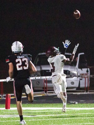 Benedictine's Trent Broadnax (3) brings in a long pass for a touchdown during a game against the host North Oconee Titans in Bogart on Friday.