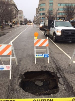 MSD closed Sixth Street Friday morning due to a sewer line collapse. The buried sewer pipe is made of brick and dates to before 1900, MSD said. Feb. 16, 2018