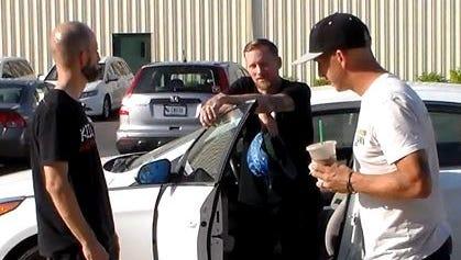 From left: Killer owner Glenn Davidson chats with pro skateboarders Mike Vallely, middle, and Kristian Svitak in Evansville.