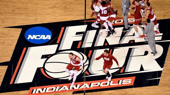 The Wisconsin Badgers celebrate beating the Kentucky Wildcats in the 2015 NCAA Men's Division I Championship semi-final game at Lucas Oil Stadium.