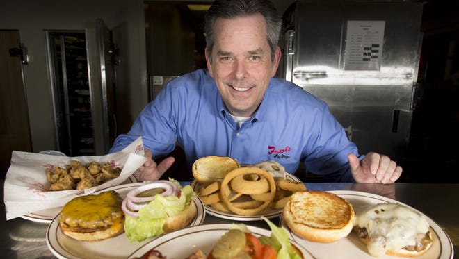 The Enquirer/Sam Greene New Frisch?s CEO Jason Vaughn poses in the kitchen at the Frisch?s Big Boy in Covington on Tuesday. Vaughn, 52, is a veteran of the restaurant industry who  was named CEO in April. Changes will include restaurant renovations and new menu items. New Frisch's CEO Jason Vaughn poses in the kitchen at the Frisch's Big Boy in Covington.