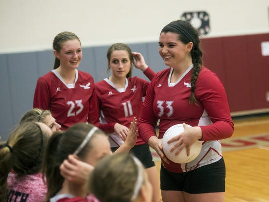 Gabrielle Emeigh is congratulated by her teammates during Thursday's game, when she broke the Bermudian Springs records for career assists and aces.