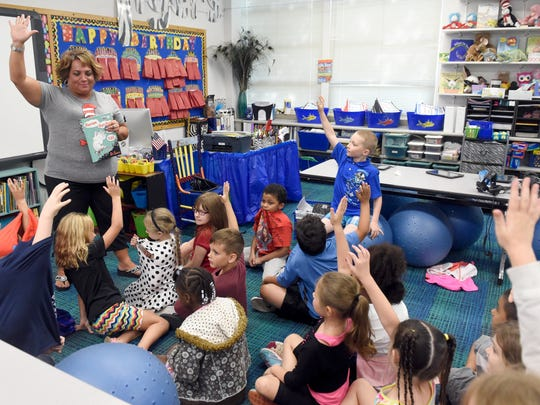 """Tekoppel Elementary School teacher Ange Dierks reads """"Horton Hatches the Egg"""" with her second grade students at the school in Evansville Wednesday.  Dierks has worked 26 years with the Evansville Vanderburgh School Corp., 23 of those have been at Tekoppel."""