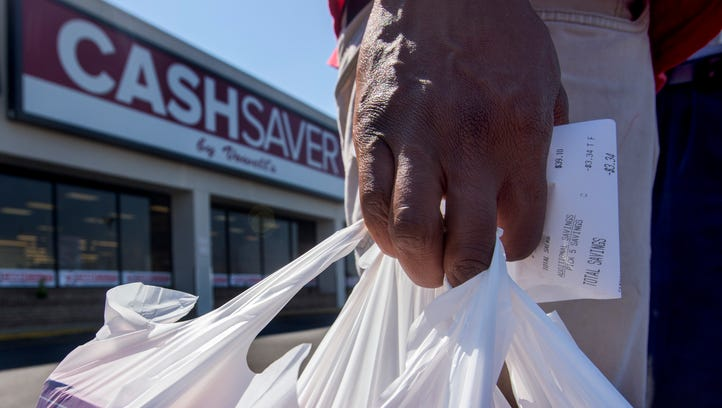 Timothy Williams carries his groceries as he discusses sales tax on groceries in Montgomery, Ala., on Tuesday March 21, 2017.