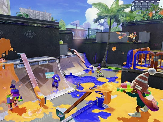 Splat foes and paint territory with ink in Nintendo's new colorful shooter, Splatoon.
