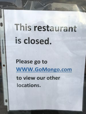 This note was posted on the door of bd's Mongolian Grill in Okemos.