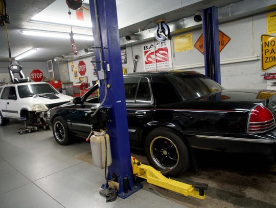 Two of Charles Williams' cars sit in his personal 2,500-square-foot