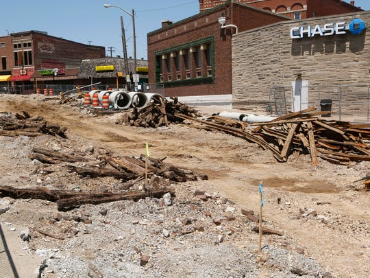 Old streetcar rails and timbers exposed near the Chauncey Village Mall by construction of the State Street Monday,  May 22, 2017, in West Lafayette.