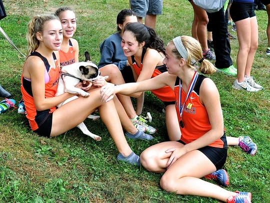 After being part of Mamaroneck's girls team-champion D1 team at the Gressler XC Run, Emily and Jane Hollander, Julia Shapiro and Anabel Martinez get some congratulatory puppy kisses from Luna Hollander.