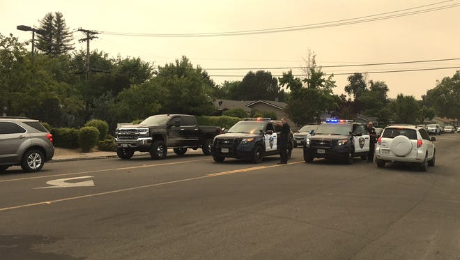 Redding police block incoming traffic Friday afternoon at Highway 273 and Westwood Avenue while also directing people out of the area due to Carr Fire evacuations. The Redding Police Department has issued mandatory evacuations for the Country Heights neighborhood and other homes in the area.