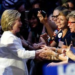 Democratic presidential candidate Hillary Clinton is greeted by supporters as she arrives at a rally in June in New York.