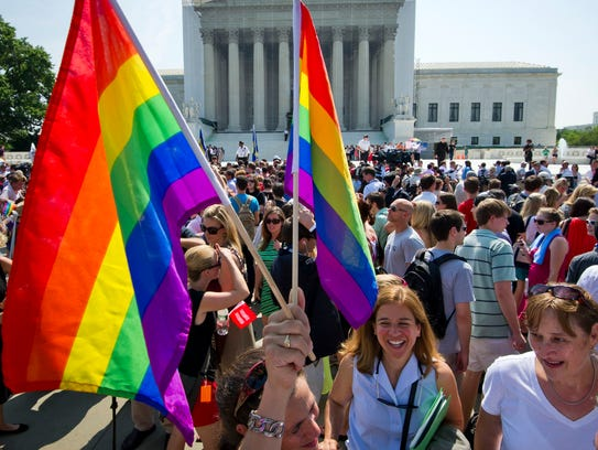 Gay rights activists gather outside the U.S. Supreme