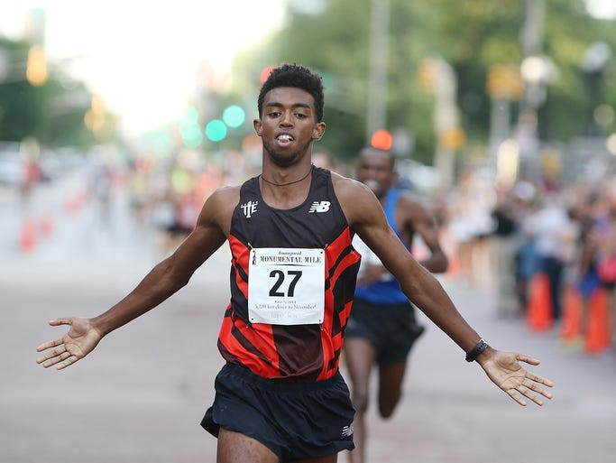 Frezer Legesse wins the Monumental Mile in downtown Indianapolis Thursday June 5, 2014.