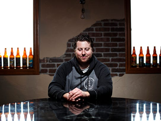 Toppling Goliath brewmaster Michael Saboe poses for