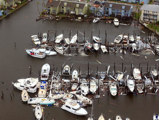 This aerial photo shows damaged boats along a dock