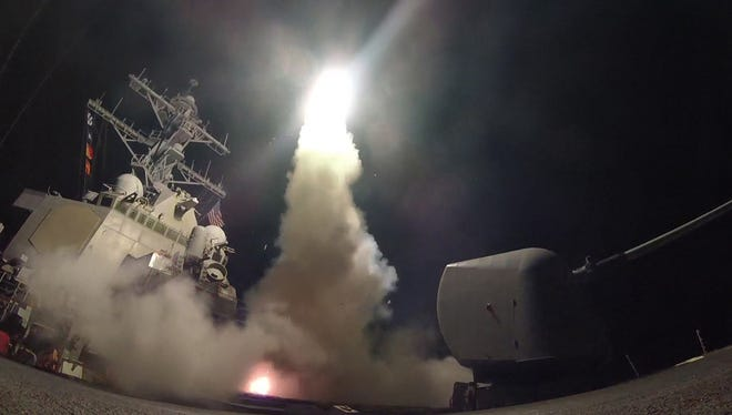 A handout photo made available by the US Navy Office of Information shows the guided-missile destroyer USS Porter launching a missile strike while in the Mediterranean Sea on Friday. The United States military launched at least 50 tomahawk cruise missiles against al-Shayrat military airfield near Homs, Syria, in response to the Syrian military's alleged use of chemical weapons in an airstrike in a rebel held area in Idlib province on Tuesday.