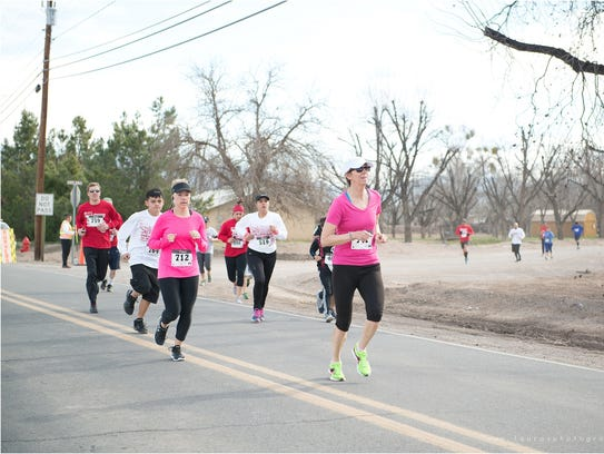 Participants run in a previous Cupid's Chase event in Mesilla. Each year, the money raised goes directly to disabled citizens of the Las Cruces and El Paso area.