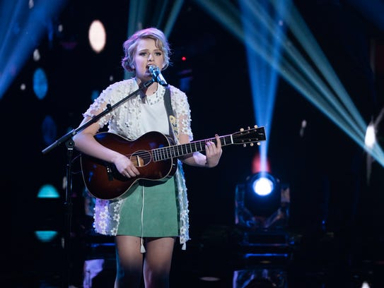Maddie Poppe of Clarksville, Iowa, sings during the
