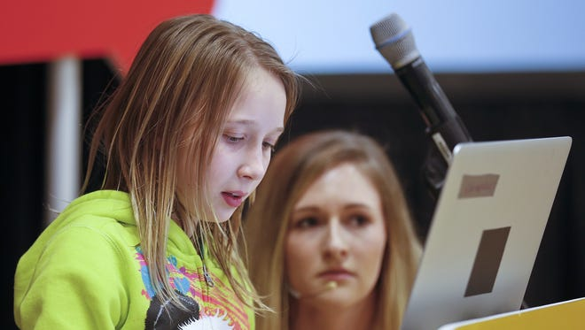 Chloe Piatt a fourth-grader at Loy Elementary School, left, types a safe password as Karissa Locke, with Google Online Safety Road Trip, looks on Tuesday.