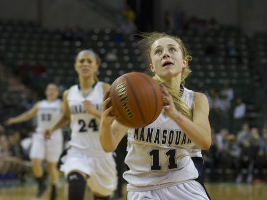 Manasquan's Stella Clark drives to the basket in the