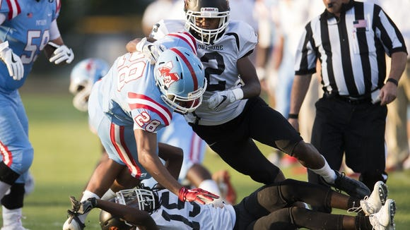 J.L. Mann's Ty Smith (28) rushed for 79 yards in the