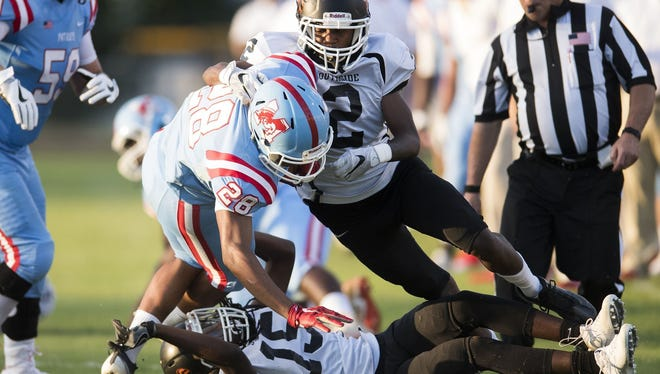 J.L. Mann's Ty Smith (28) rushed for 79 yards in the Patriots' season-opening, 20-7 victory over Southside.