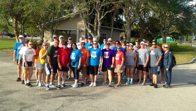 Participants in Saturday's Health First 2017 Mayors' Fitness Challenge event in Melbourne take a group photo at Front Street Park before starting their walk across the Melbourne Causeway and back.