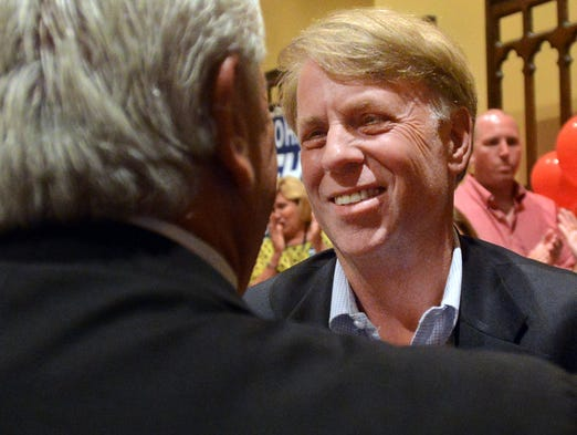 John Mehr reaches for a hug from a supporter during his election watch party at the Aeneas building, Thursday, August 7, 2014. Mehr deated Rick Staples in the race for Madison County Sheriff, 10,851 to 9,222.