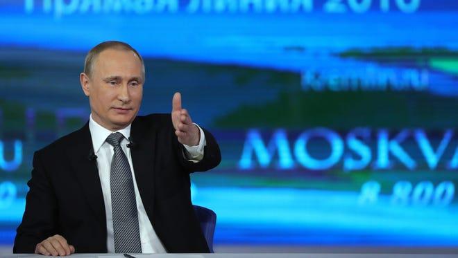 Russian President Vladimir Putin holds his annual marathon call-in show on  Russian TV on April 14, 2016. EPA/MICHAEL KLIMENTYEV / SPUTNIK / KREMLIN POOL MANDATORY CREDIT ORG XMIT: FET26