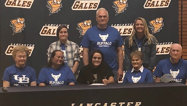 Lancaster senior Alexis Matheney, seated in center, signed her national letter of intent to play softball at the University of Buffalo. She is surrounded by her family. (Seated, left to right): Sally Weiland, Nancy Matheney, Lexie Matheney, Joy Matheney and Don Matheney. (Standing, L-R): Emily Matheney, Don Matheney, II and Kylee Matheney.