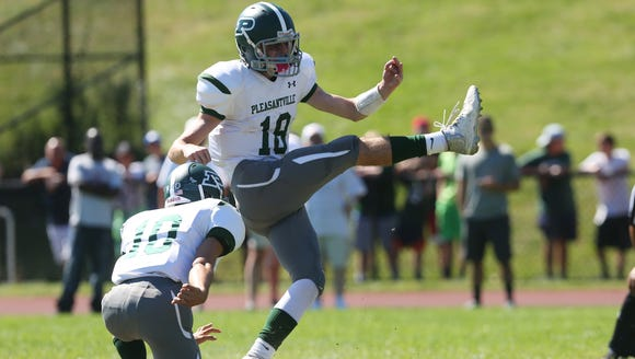 Pleasantville's Jack Howe (18) attempts an extra point during a 28-12 win at Westlake High School in Thornwood Sept. 23, 2017.
