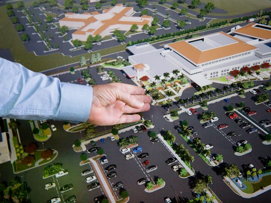 Dave Kistel, Lee Health vice president of facilities, points to an area in the parking lot that could be turned into a hospital tower in the future during a tour of the Lee Health - Coconut Point facility on Friday, March 9, 2018, in Estero.