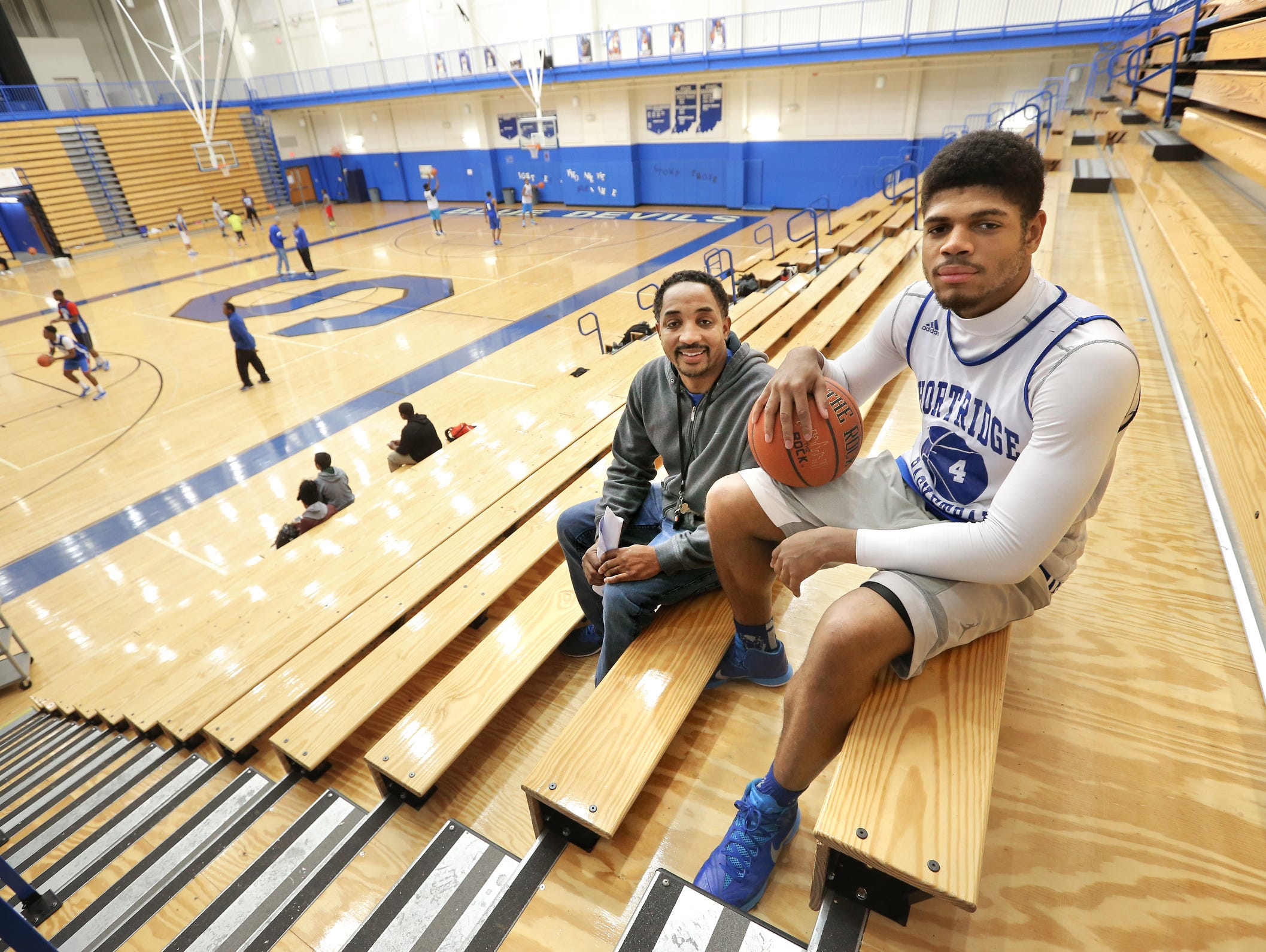 Last year, then-Shortridge High School basketball player Various Wilson was homeless and had been sleeping over on school nights with coach Donnie Bowling, left.