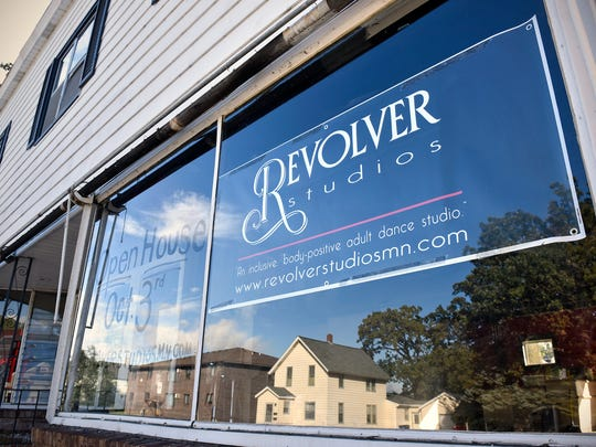 A sign announces the coming open house for Revolver Studios at the former Threads location on Ninth Avenue South in St. Cloud.
