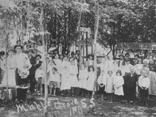 Revival attendees stand in Maple Grove near the Cold Spring depot east of Greenville in 1911.