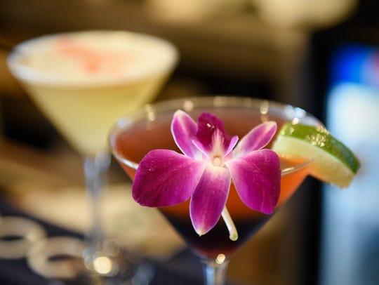 A fresh flower blossom highlights a signature cocktail